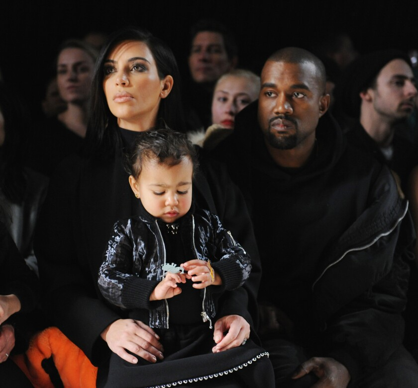 Kim Kardashian, North West and Kanye West attend the Alexander Wang fashion show at Pier 94 on Feb. 14 during New York Fashion Week.