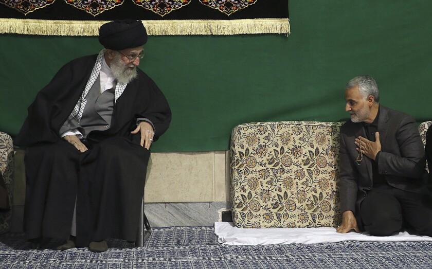 Maj. Gen. Qassem Suleimani, right, commander of Iran's elite Quds force, greets Supreme Leader Ayatollah Ali Khamenei at a mosque in Tehran in March.