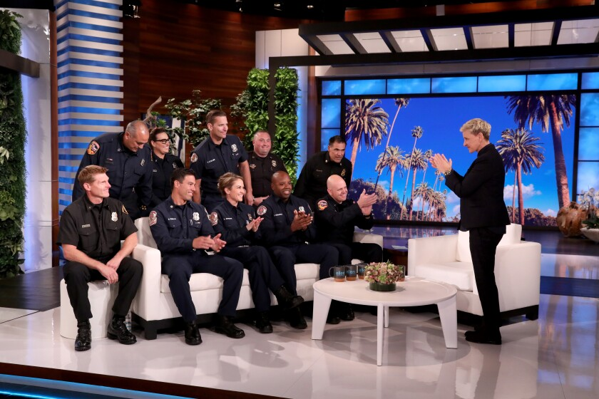 Ellen DeGeneres salutes 10 California firefighters on their day off from battling the flames.