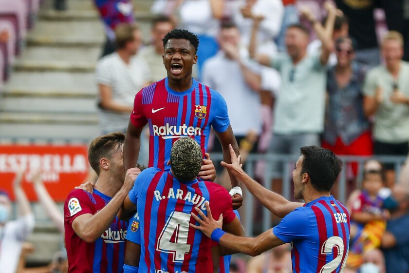 Barcelona's Ansu Fati celebrates after scoring his side's third goal during a Spanish La Liga soccer match between FC Barcelona and Levante at the Camp Nou stadium in Barcelona, Spain, Sunday, Sept. 26, 2021. (AP Photo/Joan Monfort)