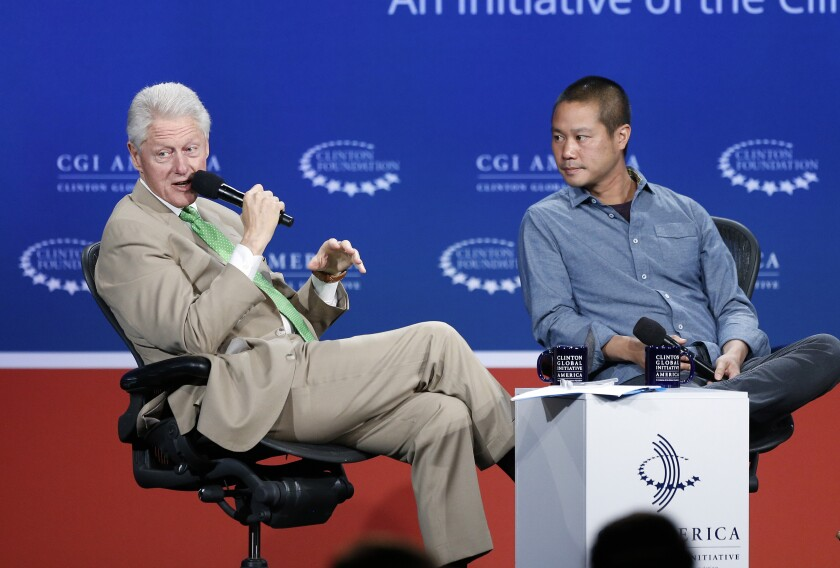 Former President Bill Clinton speaks with Zappos.com CEO Tony Hsieh