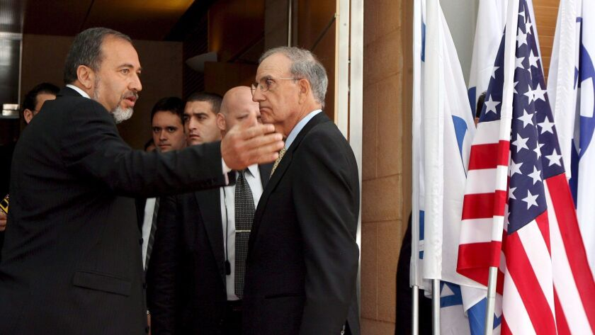 George Mitchell, right, meeting with Israeli Foreign Minister Avigdor Lieberman in Jerusalem in 2009.
