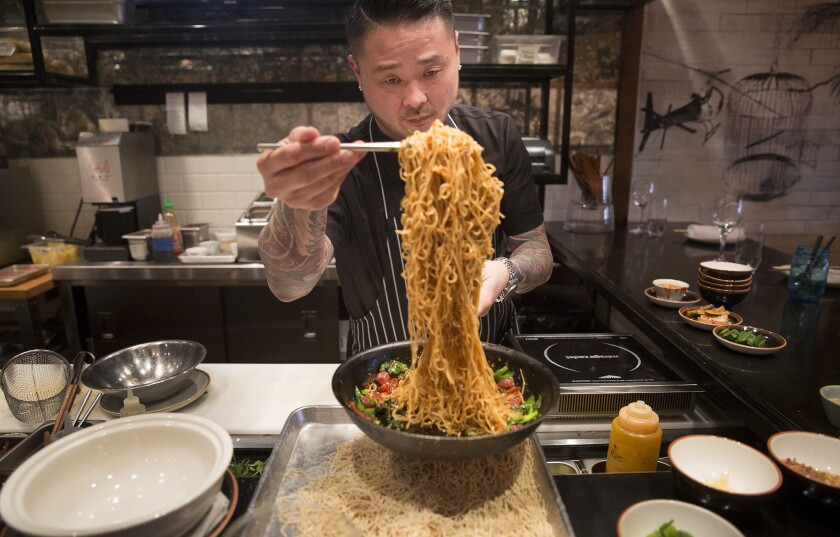 Chef Tin Vuong prepares long life noodles, a Chinese New Year staple.