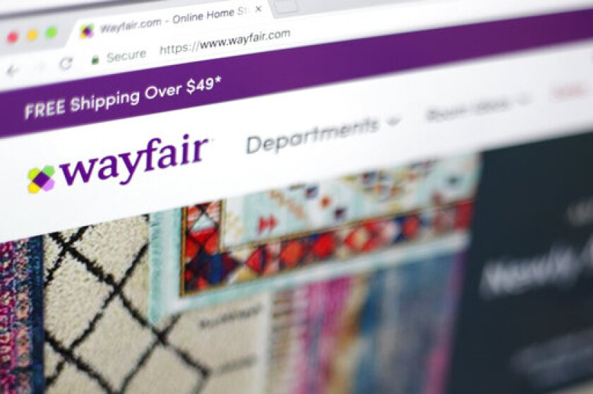 """FILE - This April 17, 2018, file photo shows the Wayfair website on a computer in New York. Self-proclaimed internet sleuths are matching up names of Wayfair's products to those of missing children as part of a baseless conspiracy theory that claims the retail giant is using storage cabinets to traffic children. Wayfair responded: """"There is, of course, no truth to these claims."""" (AP Photo/Jenny Kane, File)"""