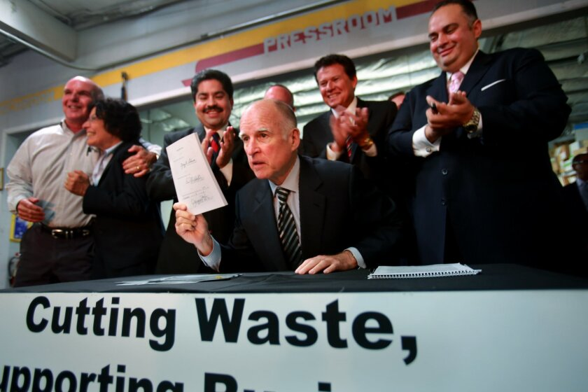 Governor Edmund G. Brown Jr. signed legislation that overhauls California's worker's compensation program. He visited Barrio Logan business Diego and Sons Printing Inc. on Sept. 18 to sign the bill, and was joined there by workers from several local labor unions, as well as Senate President Pro Tem