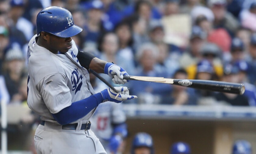 Dodgers right fielder Yasiel Puig breaks his bat while grounding out against the San Diego Padres on March 30. Puig has a ligament strain in his left thumb, but the injury likely will not warrant a trip to the disabled list.