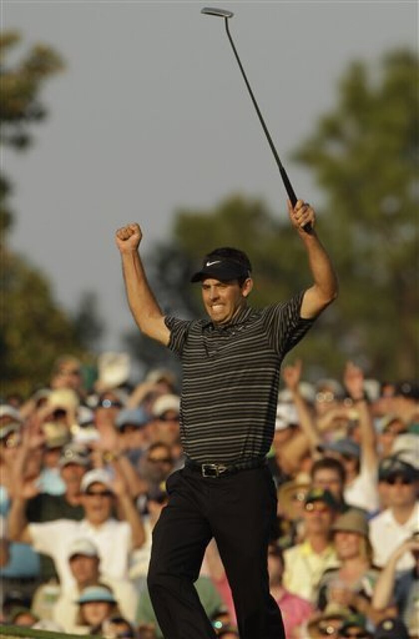 Charl Schwartzel of South Africa reacts after a birdie putt on the 18th hole during the final round of the Masters golf tournament Sunday, April 10, 2011, in Augusta, Ga. (AP Photo/Charlie Riedel)