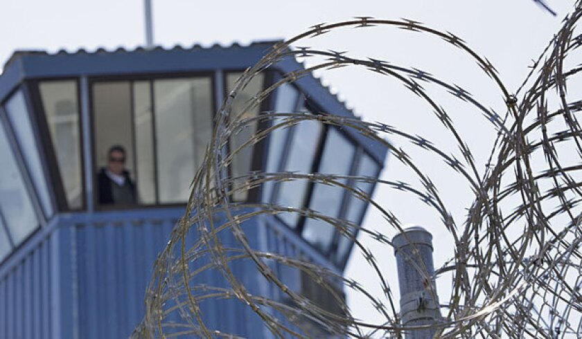 A guard tower at Pelican Bay State Prison is shown.