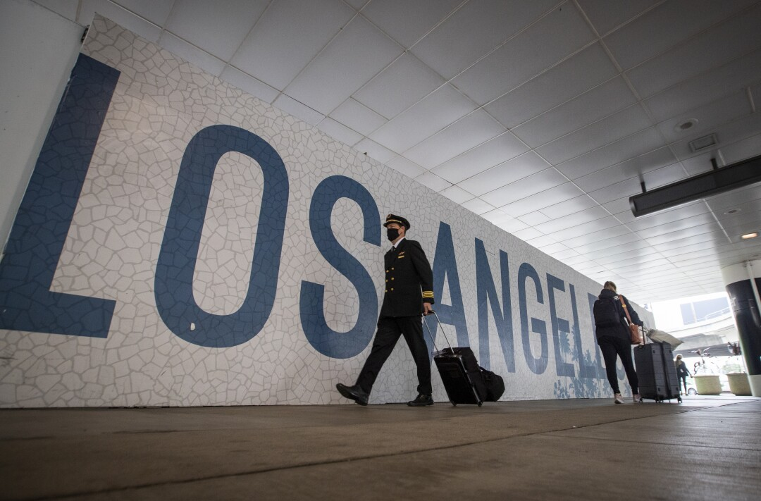 A pilot walks through a corridor at Los Angeles International Airport.