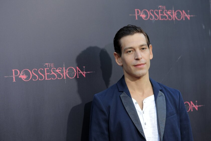 """FILE - In this Tuesday, Aug. 28, 2012, file photo, Matisyahu, a cast member in """"The Possession,"""" poses at the premiere of the film at Arclight Cinemas in Los Angeles. Following a barrage of criticism, organizers of an international reggae festival in Spain backtracked Wednesday, Aug. 19, 2015, and apologized for canceling a concert by Jewish-American singer Matisyahu because he had declined to state his position regarding a Palestinian state. Rototom Sunsplash festival said it invites Matisyahu to play as originally planned on Saturday, Aug. 22. (Photo by Chris Pizzello/Invision/AP, File)"""