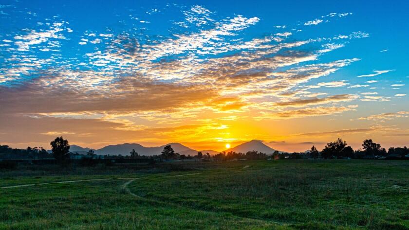 "Rich Koeberlein, a Ramona resident, took this photo on Feb. 9 in Ramona. He titled it ""Sunset and Pathways."""