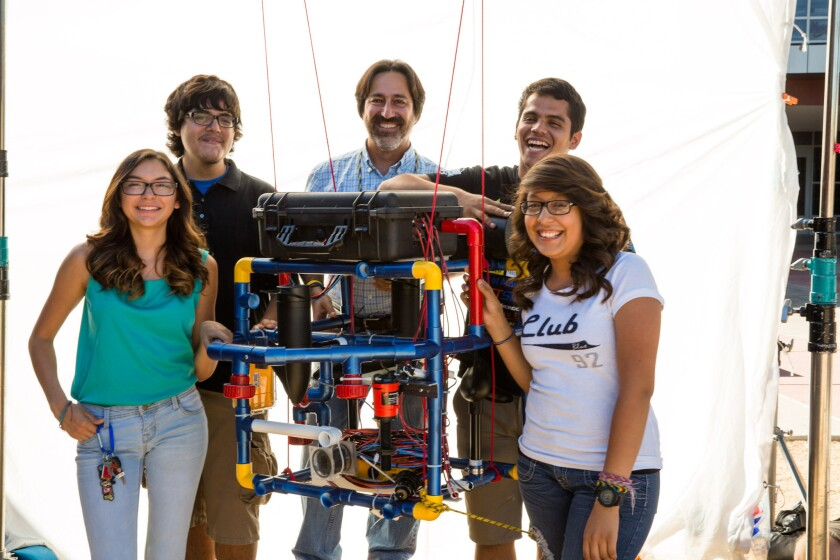 "Fredi Lajvardi (Carl Hayden Teacher), Diserea Sanders (Carl Hayden student), Sergio Corral (Carl Hayden student), Martin Carranza (Carl Hayden student), and Isela Martinez (Carl Hayden student) with Stinky in the movie ""Underwater Dreams."""