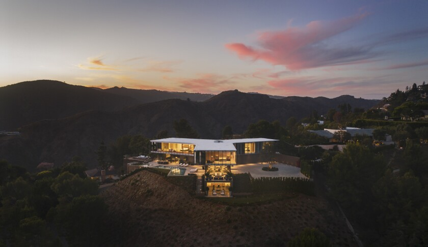 A three-winged spec home that resembles an airplane propeller is on the market for $56 million in Bel-Air.