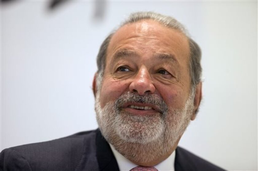 FILE - In this Jan. 14, 2013 file photo, Mexican telecommunications tycoon Carlos Slim speaks during news conference at the Soumaya museum in Mexico City. TracFone, a phone company owned by Slim, has been ordered by the state's public utility regulator to pay California $24.4 million in unpaid fees and interest. (AP Photo/Dario Lopez-Mills, File)
