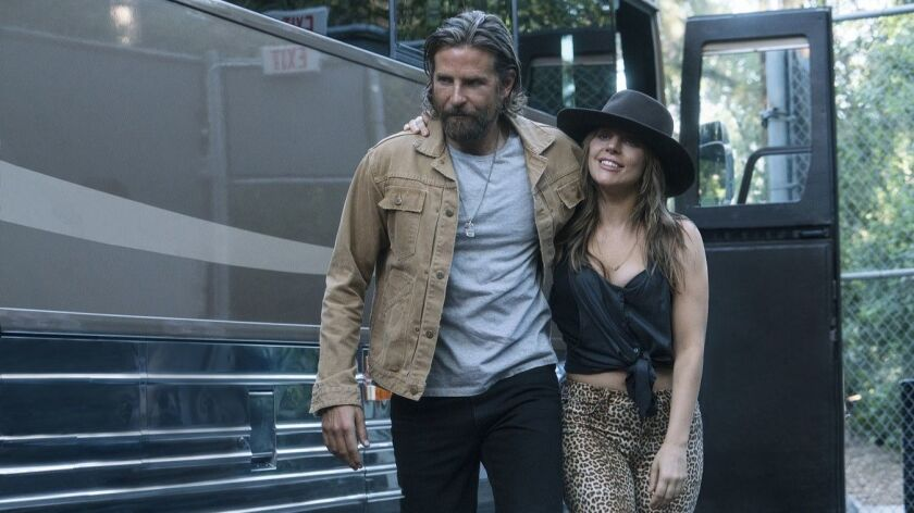 """(L-R) - Bradley Cooper and Lady Gaga in a scene from the movie """"A Star is Born."""" Credit: Clay Enos/W"""