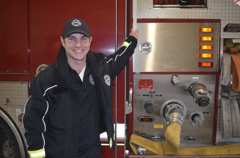 Clinton Township firefighter Ryan McCuen poses, Tuesday, Feb. 23, 2016 in Clinton Township, Mich. McCuen, a suburban Detroit firefighter, paid off a struggling family's electricity bill of more than $1,000 after responding to a call at their home. (Mitch Hotts\The Macomb Daily via AP)