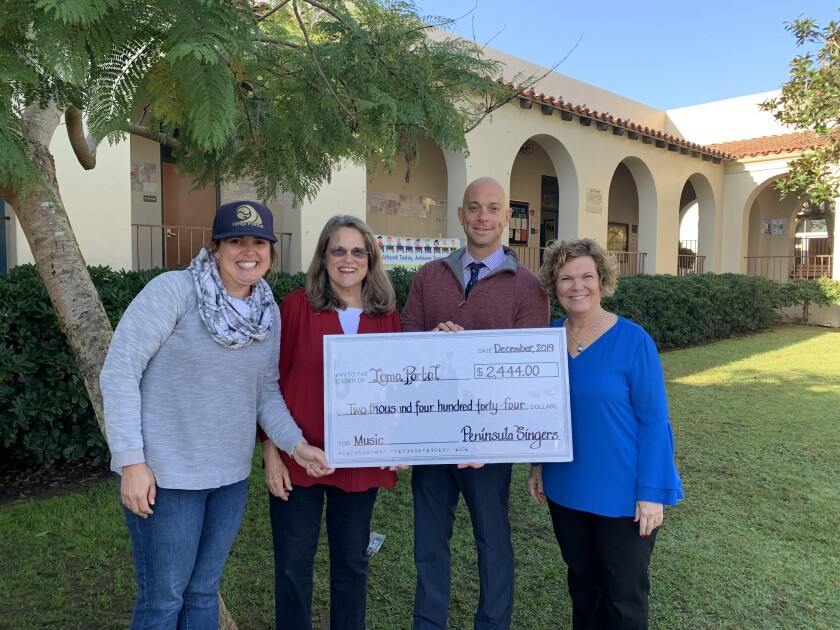 Peninsula Singers present a check to Loma Portal's Foundation president Valerie Lawson, Principal Mark Morici and music teacher Candy Szalay.