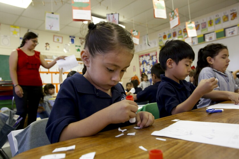 Kindergarten teacher Claudia Garcia, left, gives instructions as students work on projects at Magnolia Science Academy #7 in Northridge, which is one of three schools ordered shut down by the L.A. Unified School District last year. The school board has dropped efforts to shut the schools down.