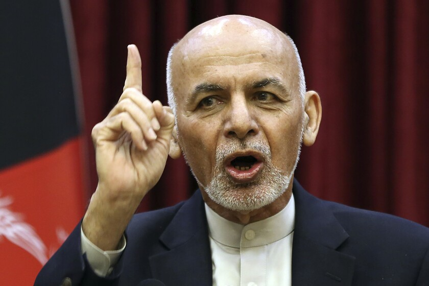 FILE - In this March, 1, 2020, file photo, Afghan President Ashraf Ghani speaks during a news conference in presidential palace in Kabul, Afghanistan. Squabbling Afghan presidential rivals threatened to declare themselves president in dueling ceremonies Monday, March 9, 2020, throwing plans for intra-Afghan negotiations into chaos. (AP Photo/Rahmat Gul, File)