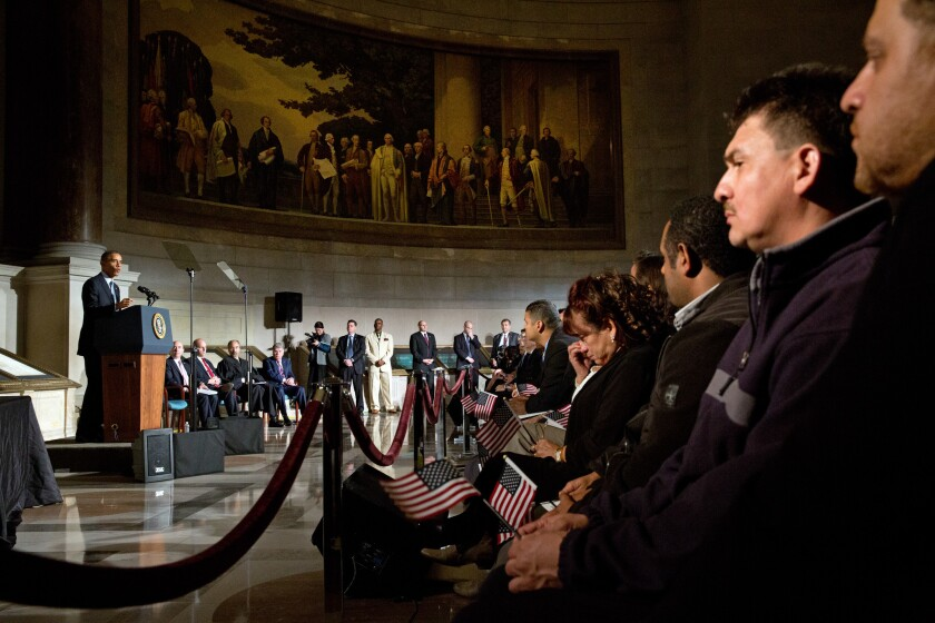President Obama speaks during a naturalization ceremony for new U.S. citizens at the National Archives on Dec. 15, 2015.