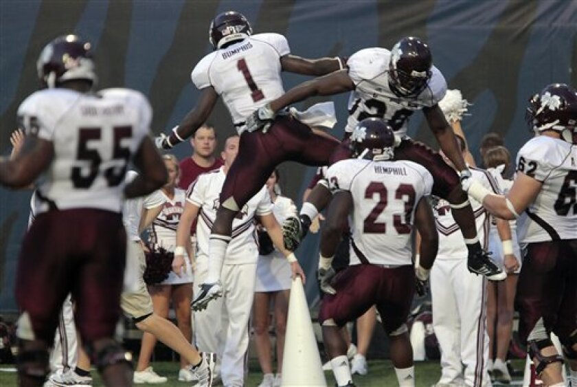 Mississippi State's Chad Bumphis (1) celebrates a touchdown with teammate Vick Ballard (28) during the first quarter of an NCAA college football game against Memphis on Thursday, Sept. 1, 2011, in Memphis, Tenn. (AP Photo/Lance Murphey)