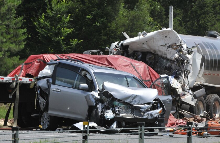 FILE - This Wednesday, June 11, 2013 file photo shows a minivan and two semitrailers which were involved in an early morning fatal wreck on I-85 South near the exit in Shorter, Ala. According to a Wednesday, July 6, 2016 report by the Centers for Disease Control and Prevention, traffic deaths are d
