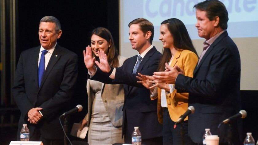 Five Democrats hoping to replace Rep. Darrell Issa, from left: Doug Applegate, Sara Jacobs, Mike Levin, Christina Prejean and Paul Kerr. About $16 million has been spent on the race.