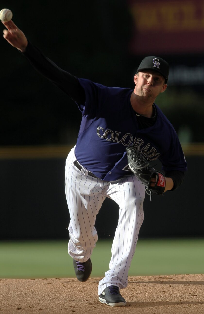 Colorado Rockies starting pitcher Jordan Lyles throws to the plate against the Arizona Diamondbacks during the first inning of a baseball game Wednesday, June 4, 2014, in Denver. (AP Photo/Jack Dempsey)
