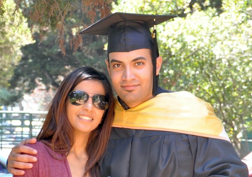 In this photo provided by the family of Abdulrahman al-Sadhan, Abdulrahman al-Sadhan poses with his sister Areej Al Sadhan for a graduation photo, at Notre Dame de Namur University, a private Catholic university, in Belmont, California, May 4, 2013. A court in Saudi Arabia has upheld a verdict that sentences the Saudi aid worker who criticized the government on Twitter to 20 years in prison and an additional 20-year travel ban after his release, drawing criticism from the Biden administration on Wednesday, Oct. 6, 2021. (Family of Abdulrahman al-Sadhan via AP)
