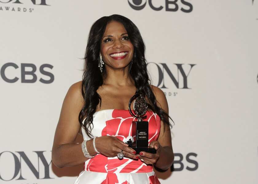 "Singer and actress Audra McDonald is shown accepting her 2014 Tony Award for her leading role in ""Lady Day at Emerson's Grill."" McDonald, who has give other Tony wins to her credit, will perform Aug. 8 at The Shell with the San Diego Symphony."