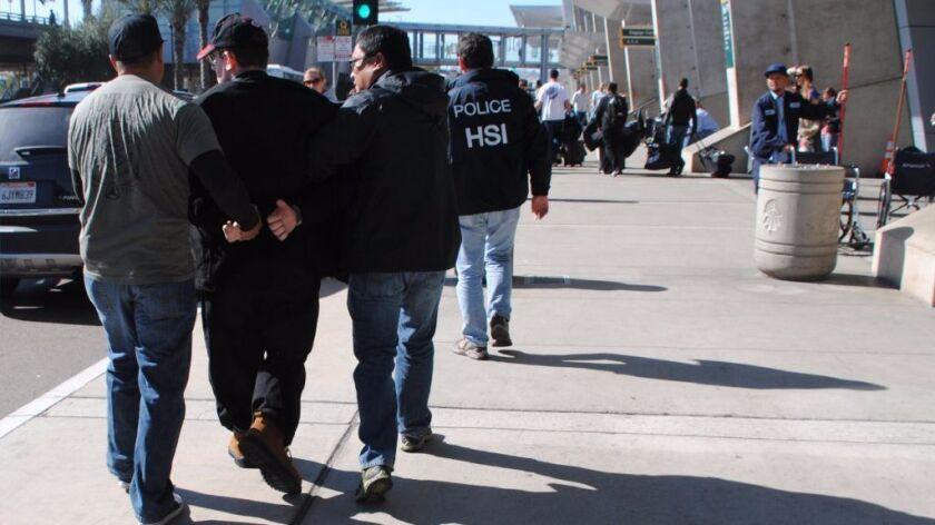 In this Jan. 29, 2016, photo, former Columbus, Ohio, seminarian Joel Wright, second left, is arreste