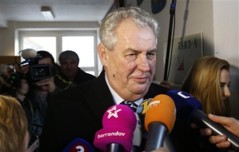 Presidential candidate Milos Zeman talks to media after casting his vote in presidential elections at a polling station in Prague, Czech Republic, Friday, Jan. 11, 2013. (AP Photo/Petr David Josek)