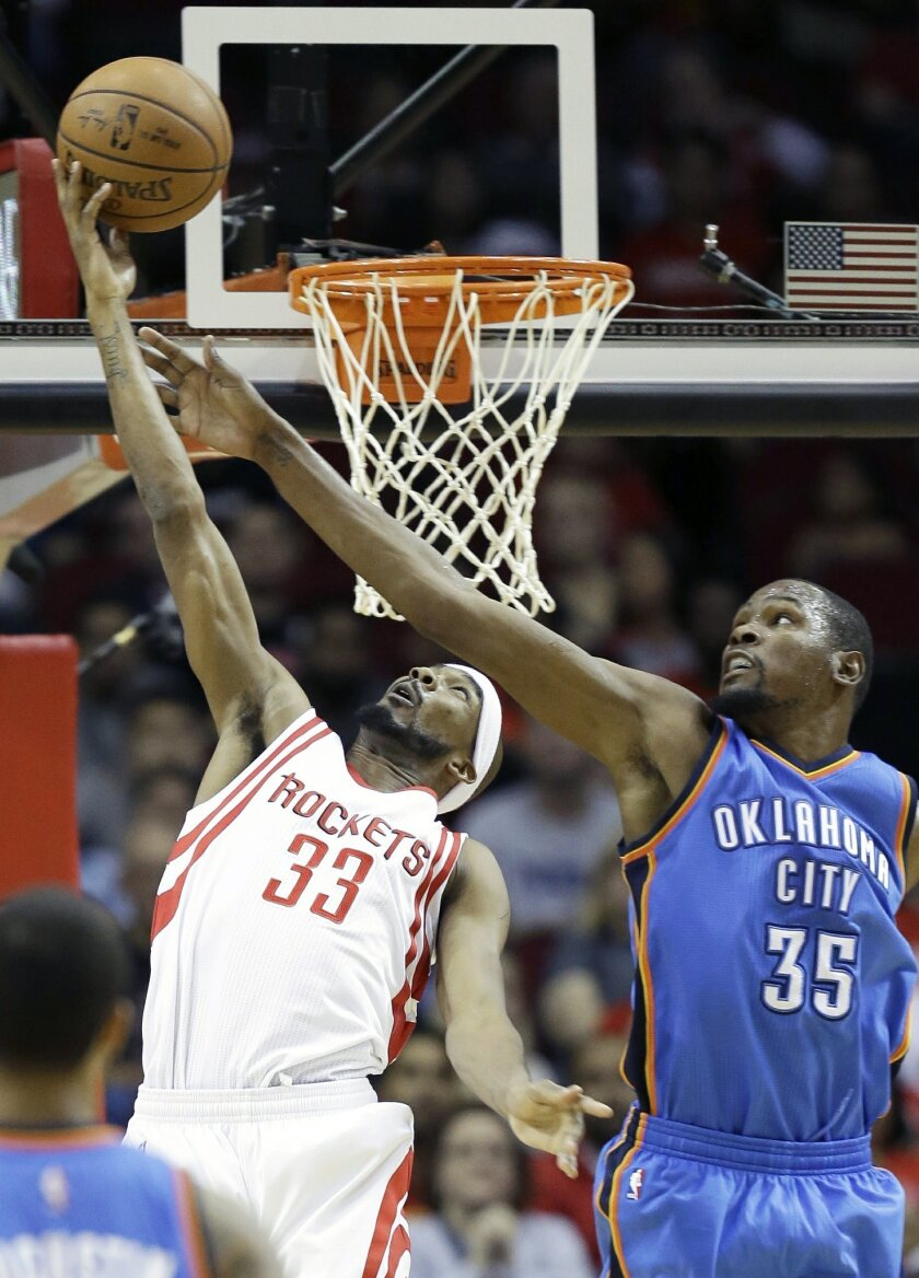 Oklahoma City Thunder's Kevin Durant (35) tries to block a shot by Houston Rockets' Corey Brewer (33) in the first half of an NBA basketball game Monday, Nov. 2, 2015, in Houston. (AP Photo/Pat Sullivan)