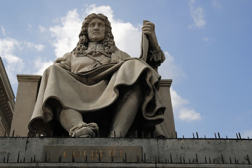 """The statue of French statesman Jean-Baptiste Colbert is pictured in front of the French National Assembly in Paris Wednesday June 10, 2020. Colbert has been a prominent minister under King Louis XIV, with the key position of controller-general of Finances from 1665 until his death in 1683. Colbert drafted the Code Noir (""""Black Code"""") which was promulgated two years after his death to regulate the conditions of slavery in French overseas colonies. Some activists combating racism have called last week on taking down the statue of Jean-Baptiste Colbert. (AP Photo/Francois Mori)"""