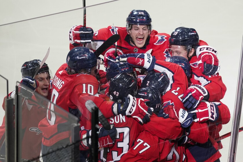 The Washington Capitals celebrate their overtime win over the Boston Bruins in Game 1 of their playoff series May 15, 2021.