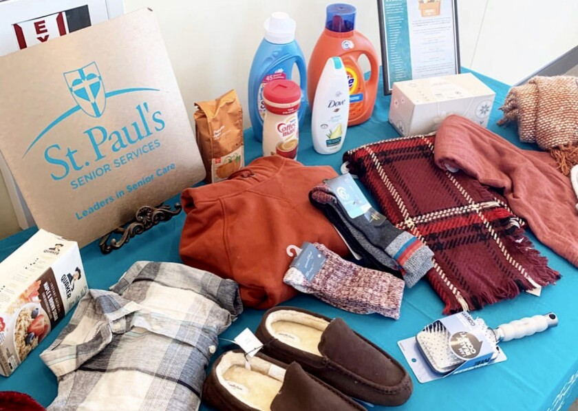A table display of socks, laundry detergent, slippers, body wash, warm clothes, coffee creamer and oatmeal.