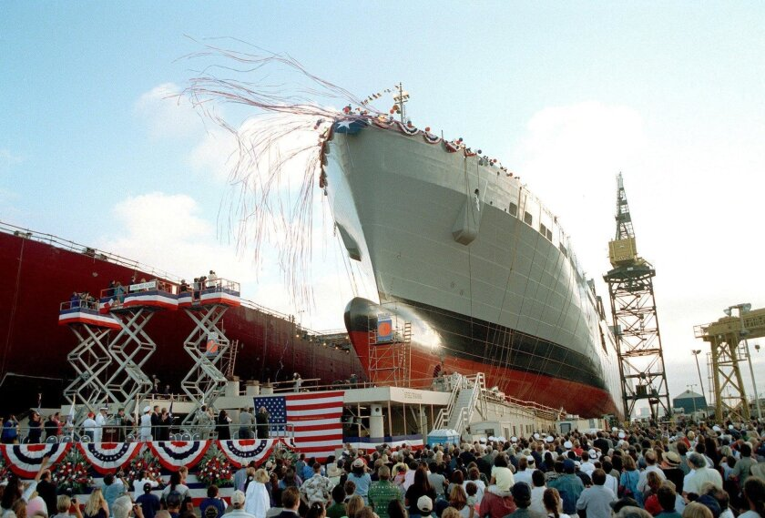 The USNS Red Cloud slides down the ways at NASSCO Ship Yard in San Diego after being christened by Anita Red Cloud and Marilyn Clemins on Aug. 7, 1999. The ship is named after Medal of Honor winner Cpl. Mitchell Red Cloud Jr., U.S. Army.