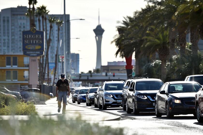 Vehicle traffic backs up along Las Vegas Boulevard in Las Vegas during a wait for food aid.