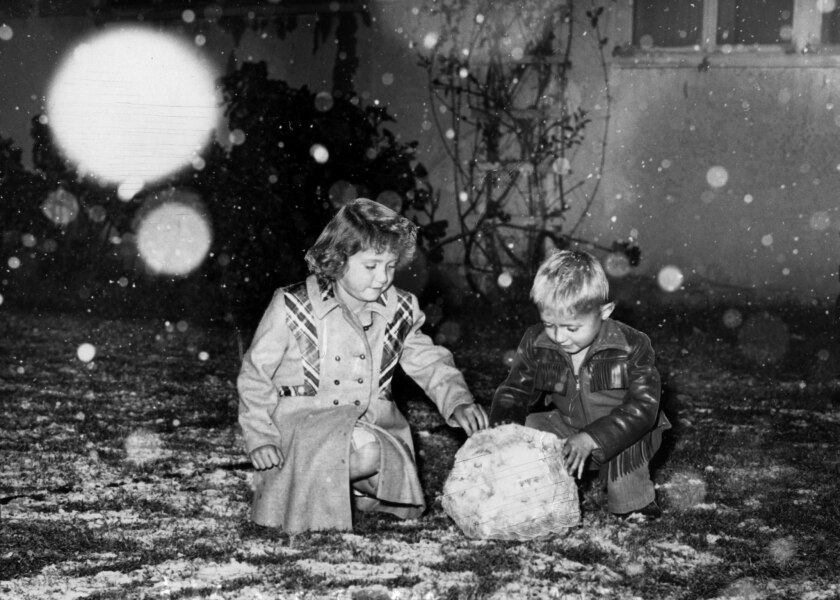 Jan. 10, 1949: Patricia and James Perkins of Riverside, like most members of a new generation, are seeing snow for the first time. This photo was published in the Jan. 11, 1949, Los Angeles Times.