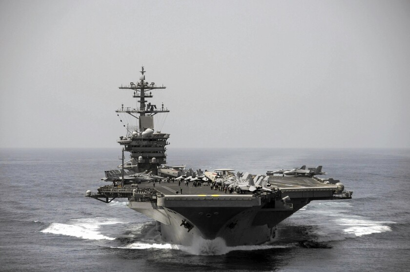 At least three dozen U.S. sailors have tested positive for the coronavirus on the aircraft carrier Theodore Roosevelt, which is now confined to port in Guam.