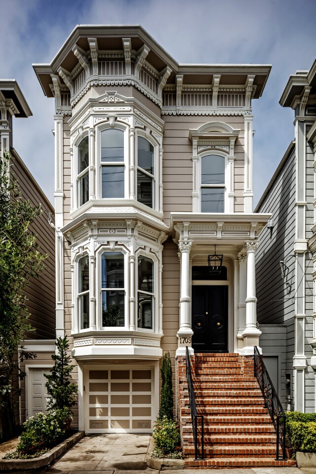 """The 1880s Victorian-style home in San Francisco is known for portraying the Tanner family home on the sitcom """"Full House."""" Jeff Franklin, who created """"Full House and the spin-off """"Fuller House,"""" bought the property four years ago for $4 million. Extensively renovated, the multilevel house features crisp white walls, custom millwork and neutral tones. Royal blue cabinetry creates visual interest in the kitchen, which is topped by row of skylights."""