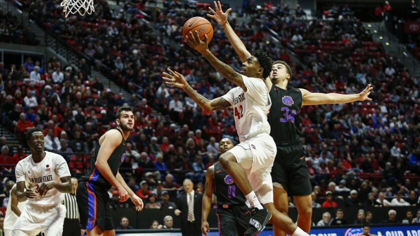 San Diego State guard Jeremy Hemsley (42) drives to the basket for a layup against Boise State guard Alex Hobbs (34) in the second half.