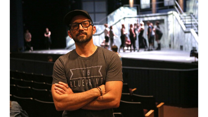 """Director Andrew Palermo stands by during the rehearsal of """"American Idiot"""" at UCI's Claire Trevor Th"""