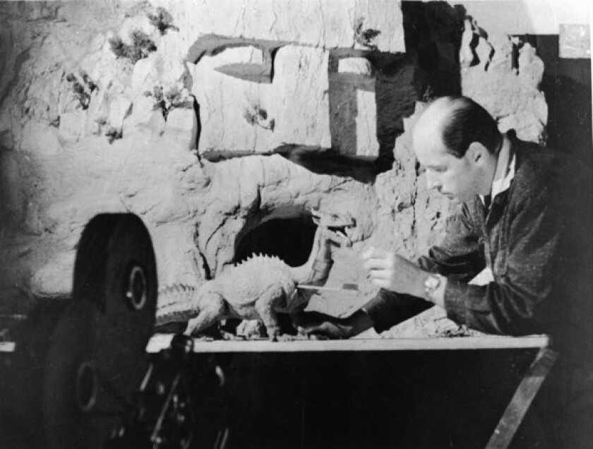 """Ray Harryhausen, best known for his stop-motion animation in """"Jason and the Argonauts"""" and """"Clash of the Titans,"""" works with a figure of a dinosaur as a camera rolls in 1965."""