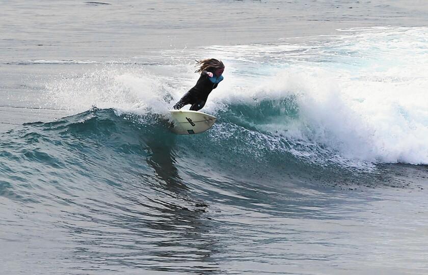 Taylor Pitz, a former junior star from Laguna Beach, surfs at her home break in Laguna.