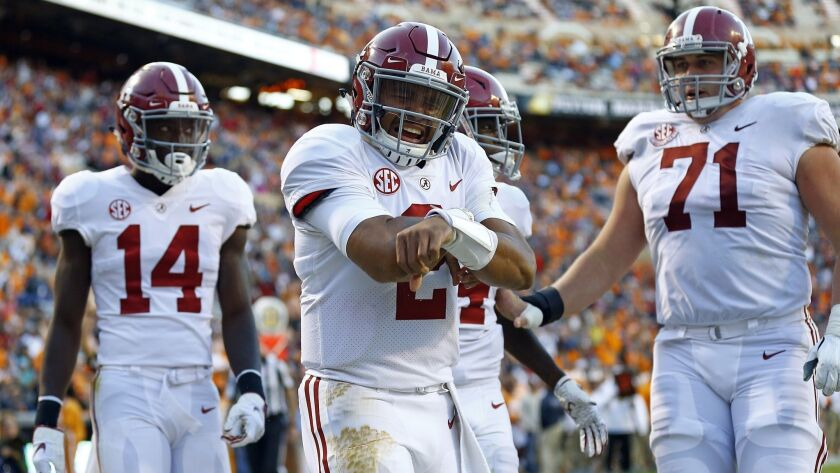 Alabama quarterback Jalen Hurts (2) celebrates after scoring a touchdown in the second half against Tennessee on Oct. 20, 2018, in Knoxville, Tenn. Alabama won 58-21.