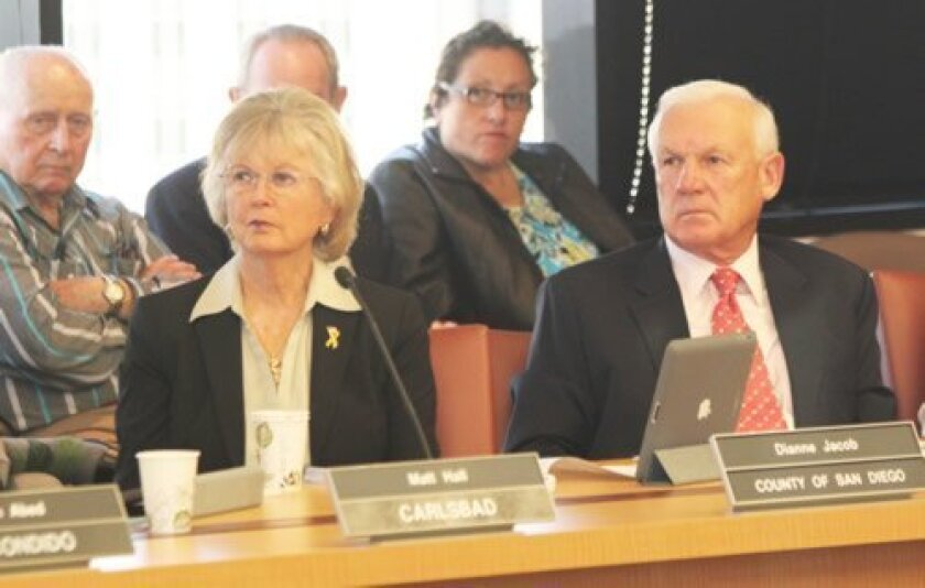 SANDAG Board members (and County Supervisors) Dianne Jacob and Ron Roberts listen as Cape La Jolla Gardens residents voice frustration over an 11th-hour trolley bridge repositioning that would impact their condominium complex.