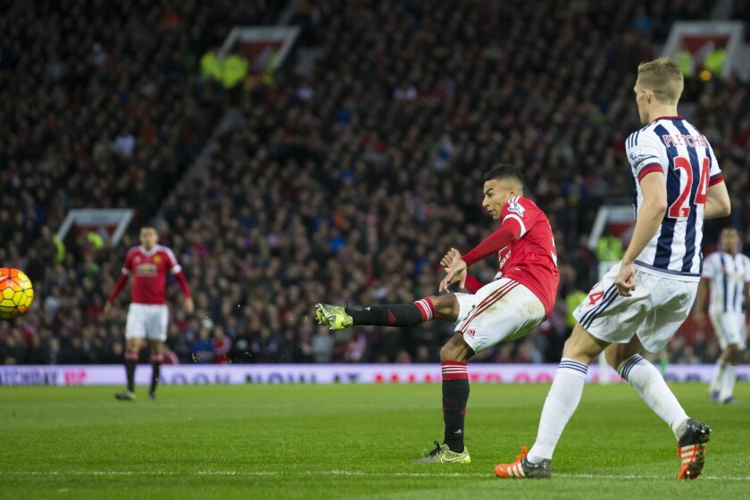 Manchester United's Jesse Lingard scores during the English Premier League soccer match between Manchester United and West Bromwich Albion at Old Trafford Stadium, Manchester, England, Saturday, Nov. 7, 2015. (AP Photo/Jon Super)