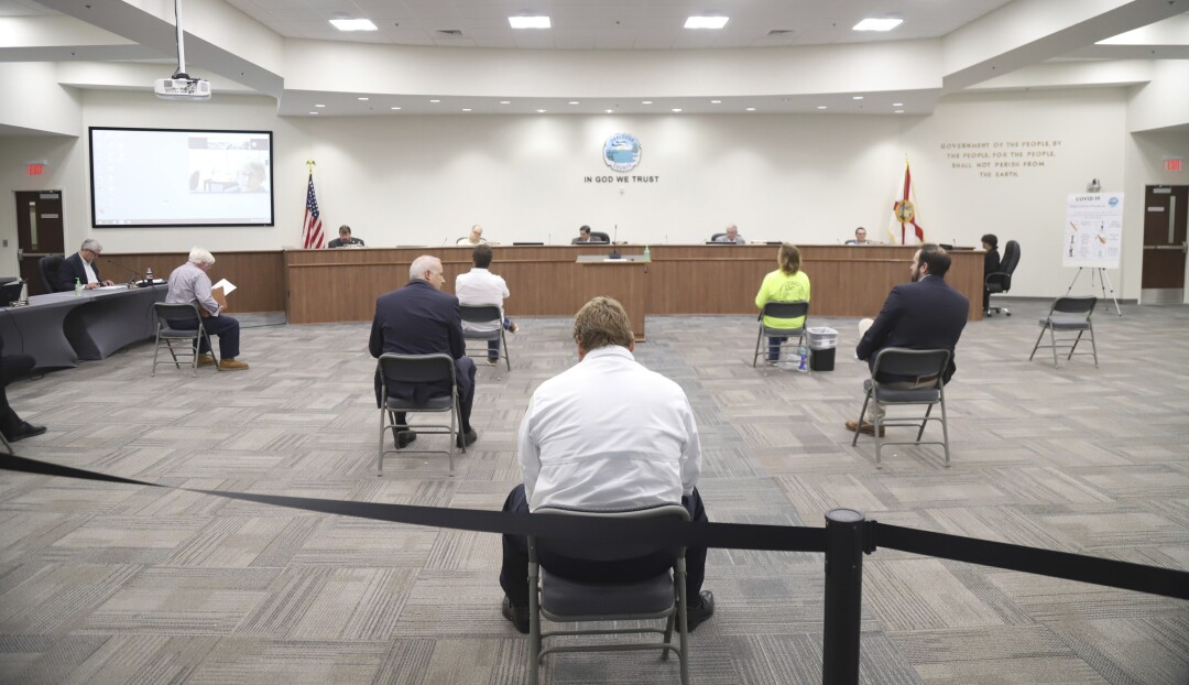 FLORIDA: Chairs are widely spaced as the Okaloosa County Board of Commissioners enacted social distancing during their coronavirus-related meeting in Shalimar, Fla.