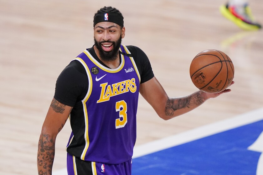 Lakers forward Anthony Davis celebrates after the Lakers advance to the NBA Finals with a win over the Denver Nuggets.